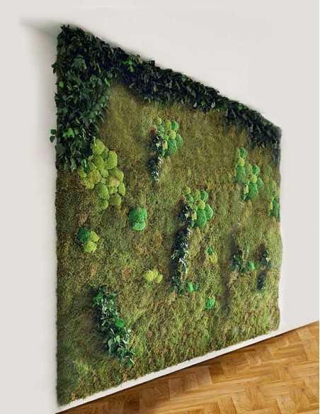 Jardín vertical de plantas preservadas y musgo colocado en pared
